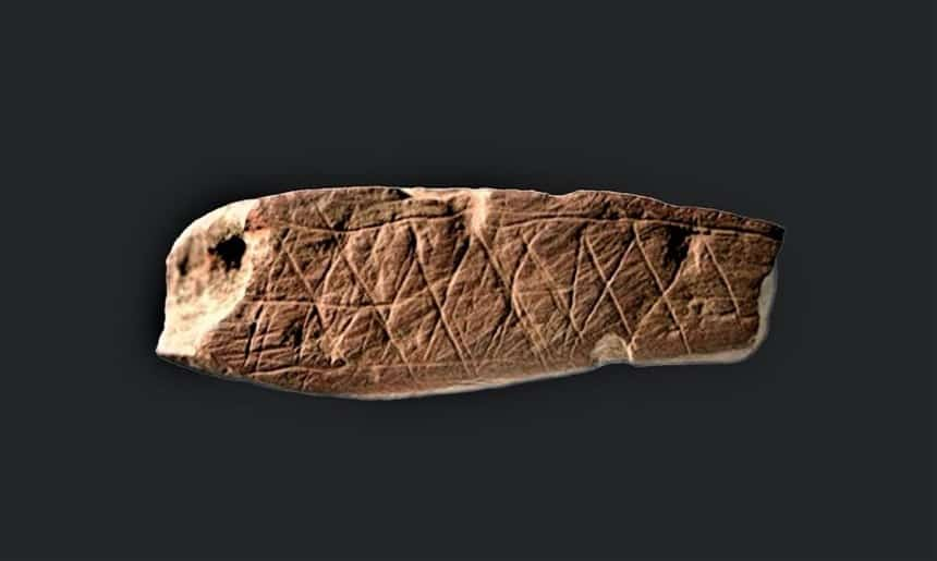 piece of ochre rock with geometric patterns found inblombox cave